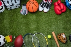Various Sport Equipments On Grass
